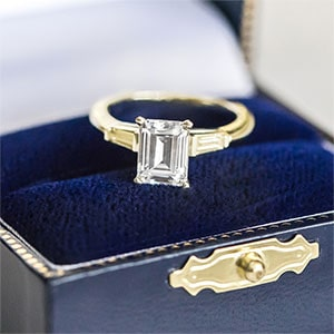 Three Stone Emerald Cut Engagement Ring in 18k White Gold