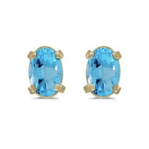Oval Blue Topaz Stud Earrings in 14k Yellow Gold (1.14tcw)