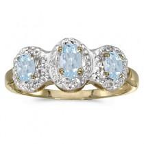 0.50tcw Oval Aquamarine and Diamond Three Stone Ring 14k Yellow Gold